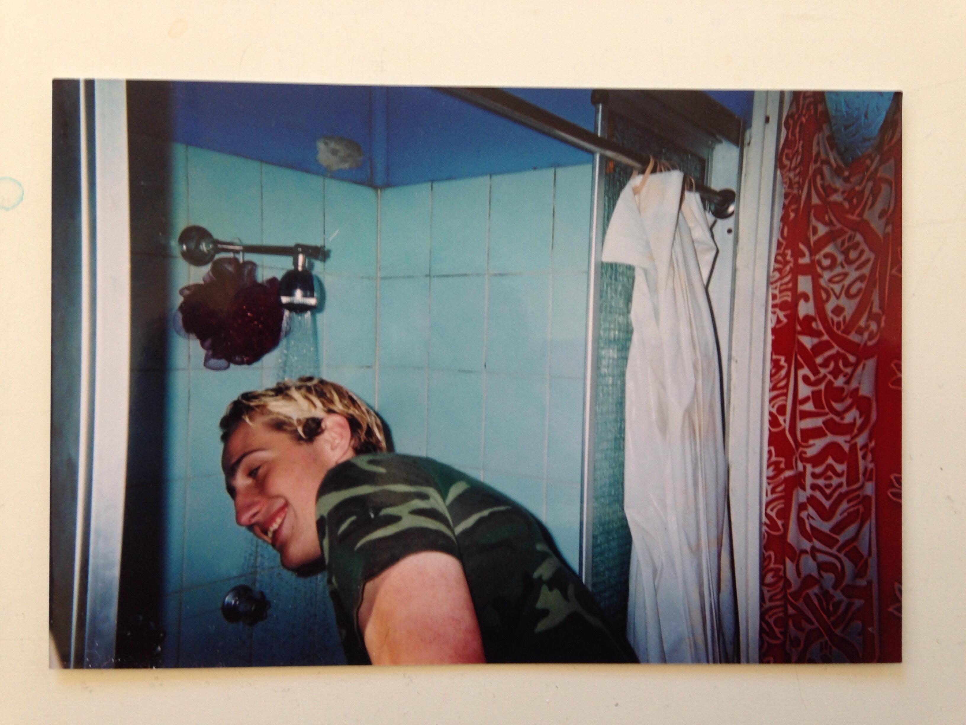 John-Gascoigne-shower-curtain-bleach-hair-blue-tiles