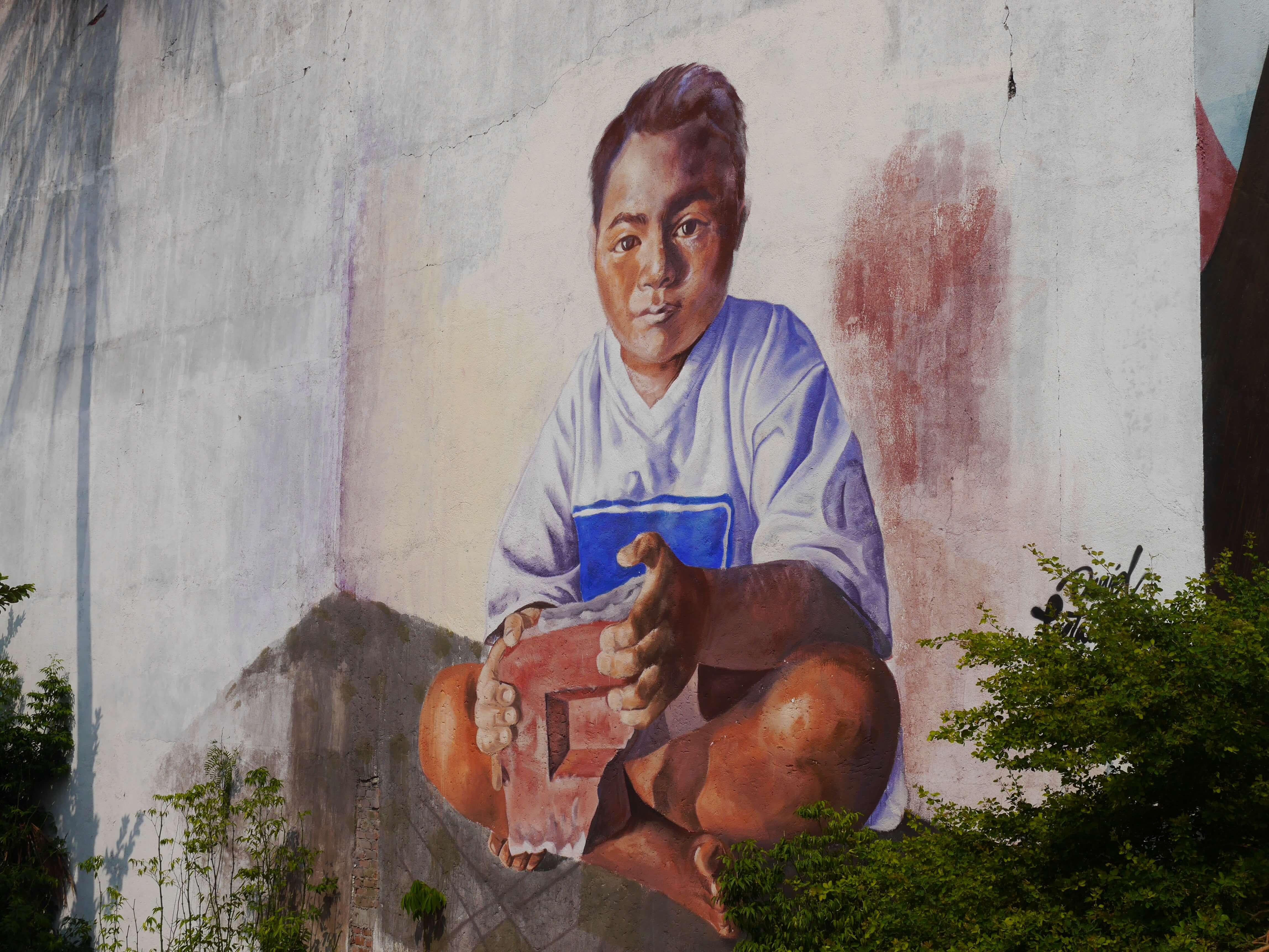 Juchitán-mural-niño-ladrillo