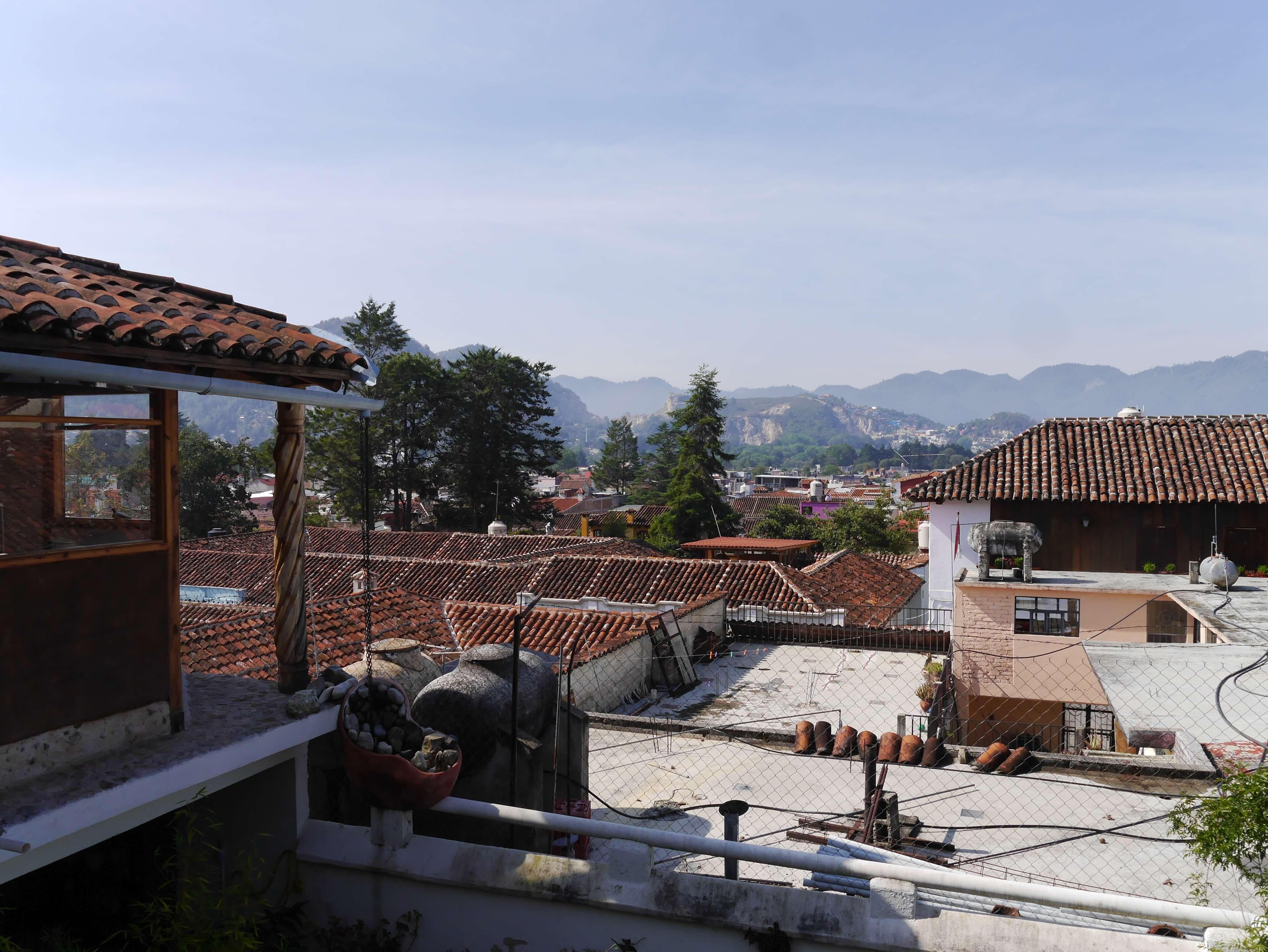 San-Cristobal-roofs-tiles-hills-sky